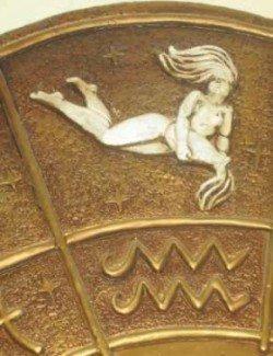 Gold aquarius waterbearer and symbol