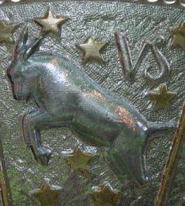 Capricorn goat with symbol metal