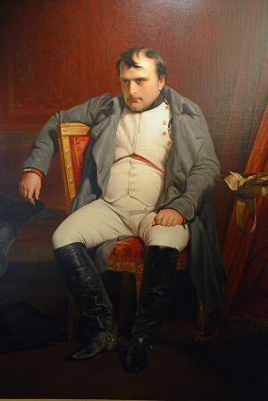 man sitting painting